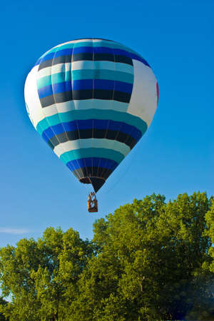 Colorful hot air balloon travelling to the sky Stock Photo - 7704369