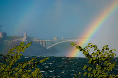 colorful Ranibow over the falls and the water