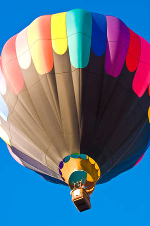 Colorful hot air balloon travelling to the sky photo