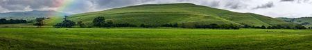 Panorama - Green mountain landscape with rainbow Reklamní fotografie
