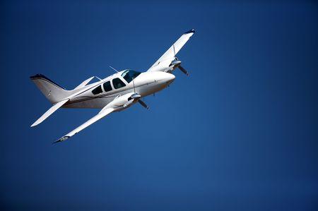 Small airplane against blue sky Reklamní fotografie