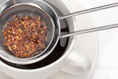 Close-up of a tea strainer full of leaves (focus on tea leaves)