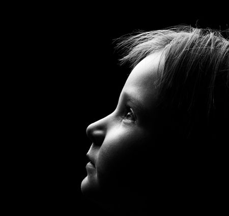 Profile of a childs face with high contrast light