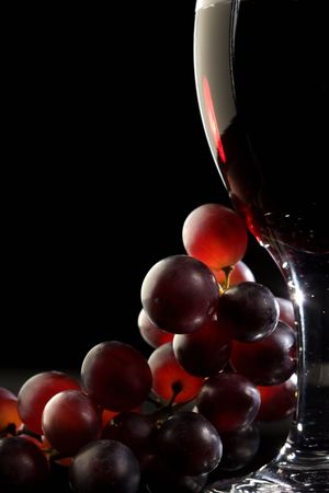 Close-up of red grapes and a glass of red wine Reklamní fotografie
