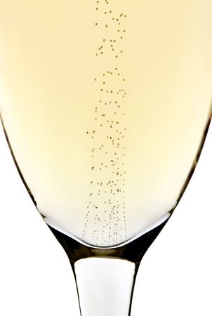 Rising bubbles in a champagne glass with white background Stok Fotoğraf