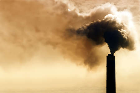 greenhouse effect: Heavy smoke from industrial chimney polluting the environment