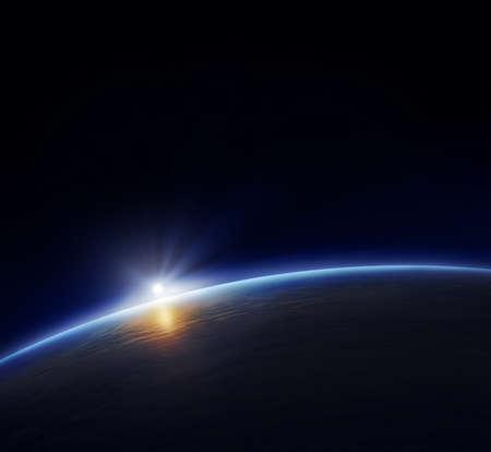 the universe: Planeta tierra con el sol naciente en el espacio