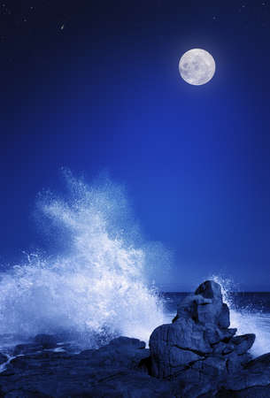 Rising moon over Rocky coastline at night   Elements of this image furnished by NASA  moonmap  http   visibleearth nasa gov  photo