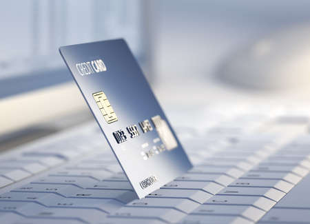 e systems: Credit Card on keyboard with desktop computer system in background - 3d
