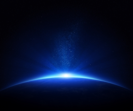 Earth - sunrise in deep blue space  photo