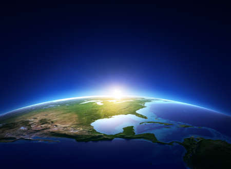 sun rise: Earth sunrise over cloudless North America  Elements of this image furnished by NASA  Stock Photo
