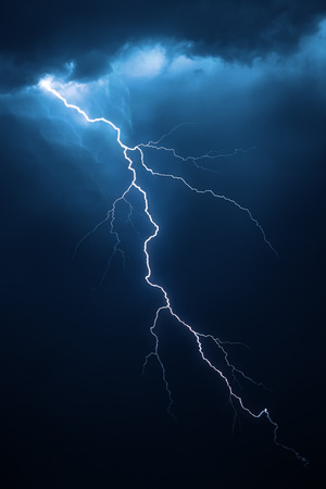 Lightning with dramatic clouds composite image