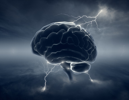 Brain in stormy cloudscape and lightning - conceptual of brainstorm