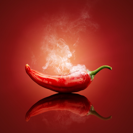 Hot chili red smoking or steaming with reflection Archivio Fotografico