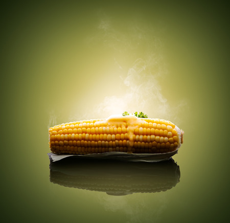 Cooked Ear of Corn with melting hot butter and steam