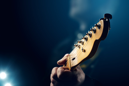 Guitarist on stage - closeup with selective focus on head