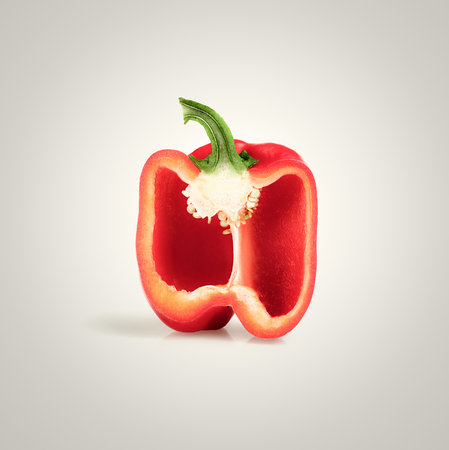 Cross-section of a Red Pepper on white gradient background