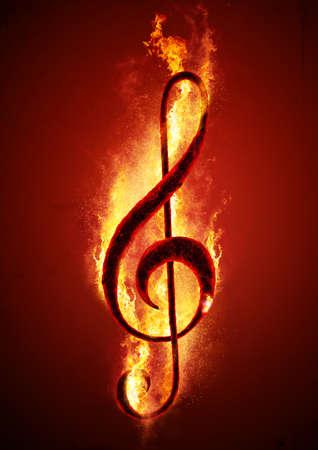 화재에 뜨거운 숯불에서 뮤지컬 메모 (고음 음자리표). 뜨거운 음악의 개념적 이미지입니다.