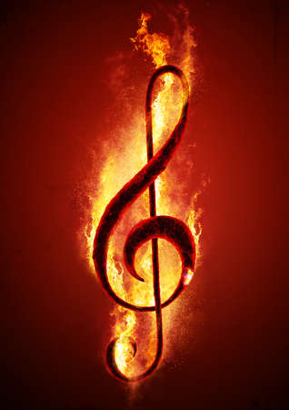 Musical note (treble clef) from hot charcoal on fire. Conceptual image of hot music. Reklamní fotografie - 59422239