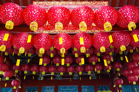 Lanterns hanging on ceiling of Chinese temple in George Town, Penang, Malaysia photo