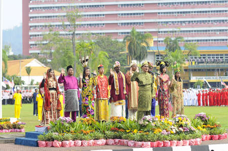 KUANTAN, MALAYSIA -SEPT 16: A group of Malaysian youth from all races reads their pledge on celebrating Malaysia 54th anniversary of independence on September 16, 2011 in Kuantan, Pahang, Malaysia.