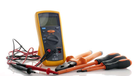 An impedance mutimeter complete with probe and  a electrical insulated plier and three insulated screwdriver completed with philips and flat types. Stock Photo - 11112154