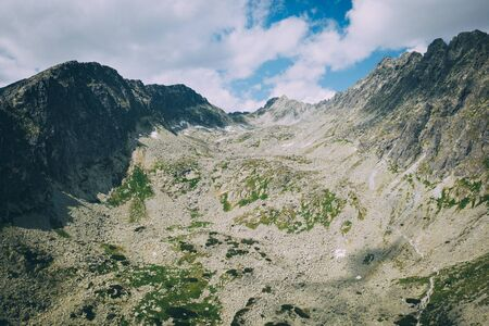 High Tatras mouintans from drone point of view. Rocky mountains, lakes, and sunny summer weather. It was nice travel trip to these europian mountains - National park. This is nearby Lomnicky stit and Kriva and Strbske pleso.