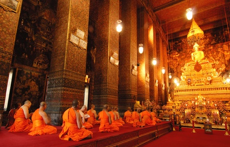 Buddha image and monks in Wat Pho Temple, Bangkok, Thailand  Editorial