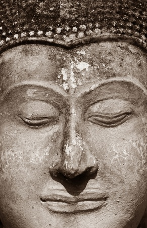 Ancient Buddha face, Ayutthaya, Thailand  photo