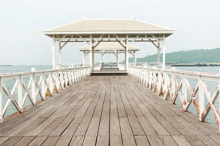 Beautiful wooden pier in Ko Si Chang island,Thailand photo
