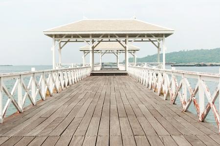 Beautiful wooden pier in Ko Si Chang island,Thailand photo