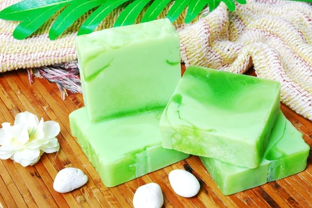 Handmade soap bars on Bamboo mat with Jasmine flowers and leaf  photo