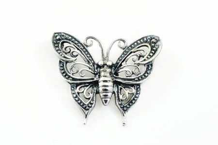 Silver pendant (butterfly shape) on a white background Stock Photo - 12628681