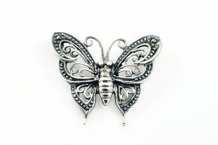 diamond jewellery: Silver pendant (butterfly shape) on a white background  Stock Photo