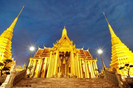 The Royal Pantheon at Wat Phra Kaew in Bangkok, home of the Emerald Buddha, at night photo