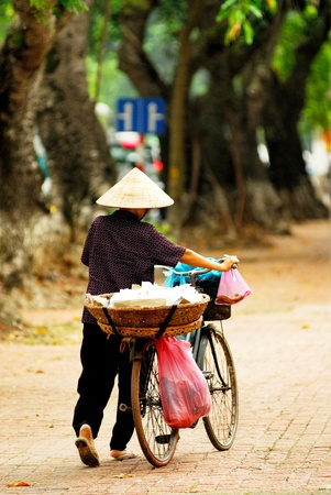 Woman riding bicycle in Vietnam