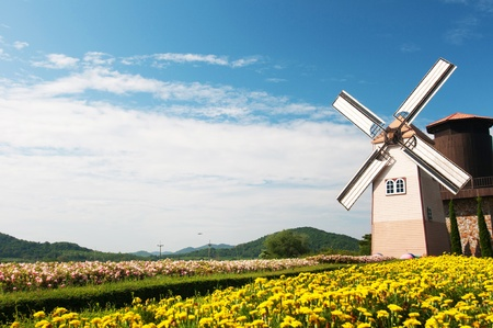 Wooden windmill on blue sky background  photo