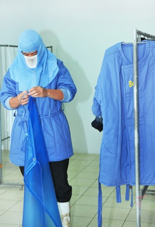 A man wear hygiene clothes in factory Editorial