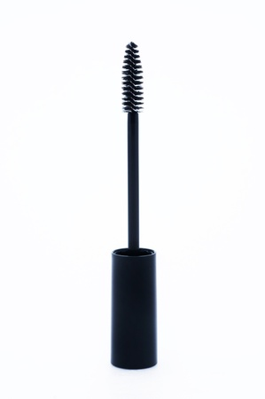 Close-up mascara brush isolated on white background  photo