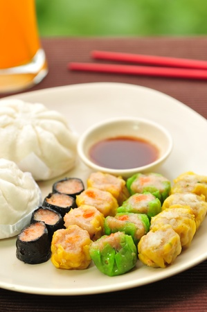 Dim sum, Chinese steamed pork , shrimp dumplings and steamed buns  photo