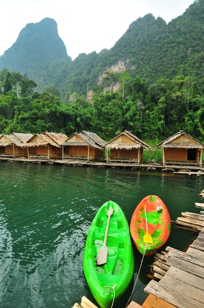 Kayak and hut in the lake,thailand photo