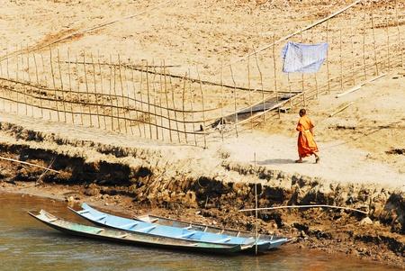 khan: Monks crossing the Nam Khan River, Luang Prabang, Laos