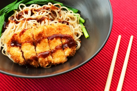 Pork fritter noodle topped with japanese sauce photo