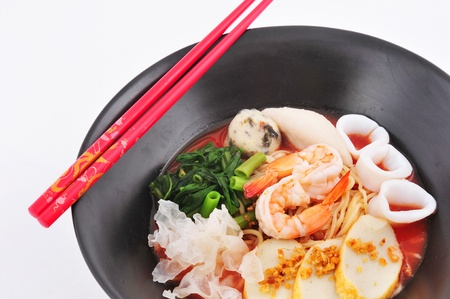 Rice Noodles with shrimp and fish ball in red soup  Yen Ta Fo   photo