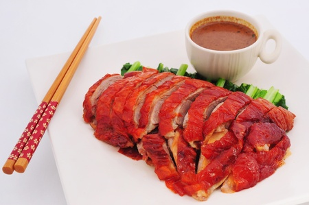 Roast duck sliced portions on plate with Sauce  chinese cuisine Stock Photo