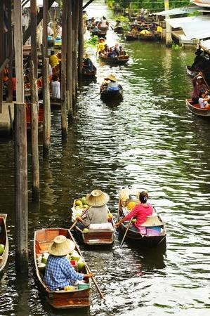 Three vendors on Damnoen Saduak Floating Market near Bangkok in Thailand