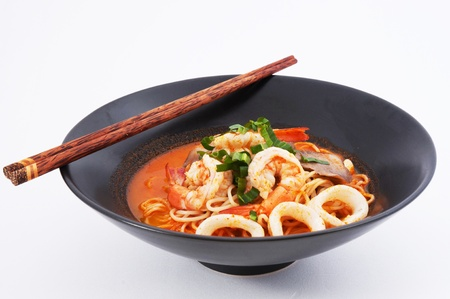 Tom Yam Koong and Squid soup with noodles  Thai cuisine