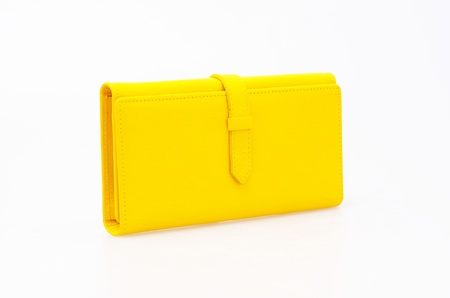 yellow purse on a white background  photo