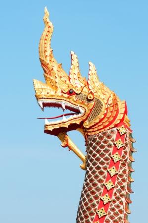 Head of naka statue on blue sky photo