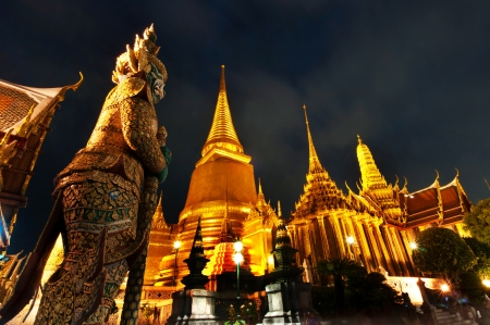 Night Scene of Wat Phra Kaew s Pagodas From the Grand Palace of Thailand  photo